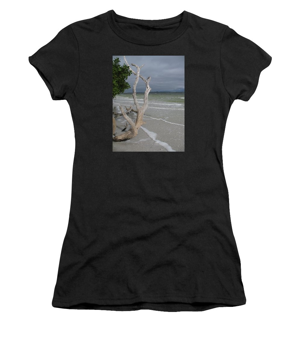 Beach Women's T-Shirt (Athletic Fit) featuring the photograph Driftwood On The Beach by Christiane Schulze Art And Photography