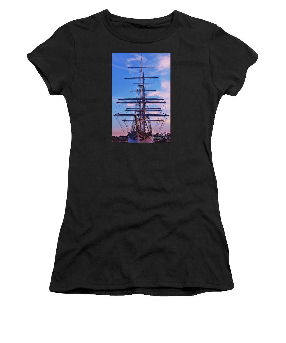 Tall Ship Art Baltimore Nautical Masts Maritime Sailing Ship Outdoors Inner Harbor Sunset Stratsraad Lehmkuhl Historic Vessel Serenity Norwegian Tall Ship Vertical Vision Canvas Print Wood Print Metal Frame Available On Phone Cases New Spiral Notebooks T Shirts Shower Curtains Greeting Cards Tote Bags And Mugs Women's T-Shirt (Athletic Fit) featuring the photograph A Tall Ship At Sundown In Baltimore by Marcus Dagan