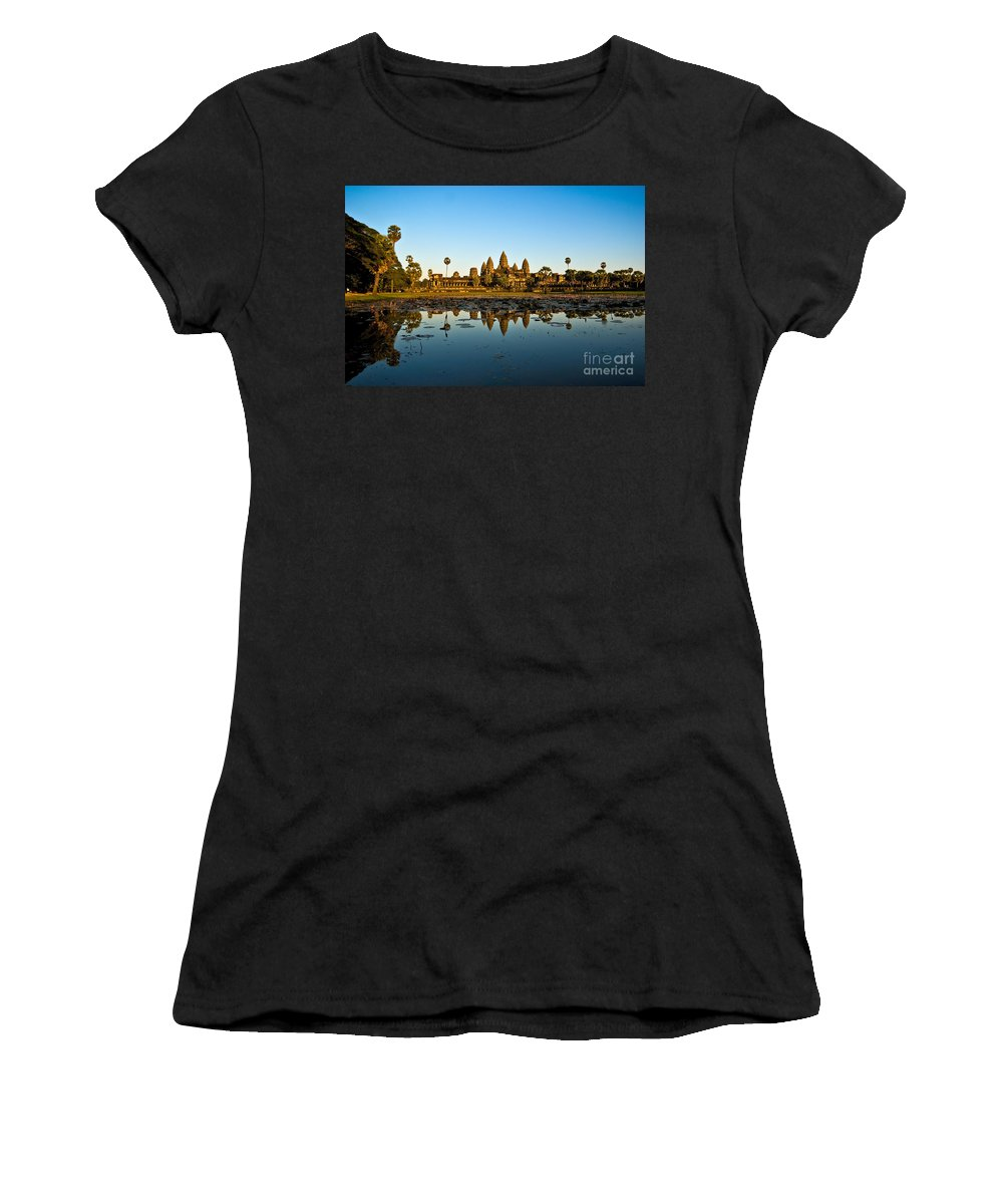 Ancient Women's T-Shirt (Athletic Fit) featuring the photograph Angkor Wat At Sunset - Cambodia by Luciano Mortula
