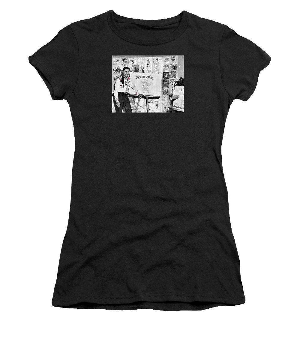Chuck Amesbury Aka Chuck Waggin Cartoon Corral Kvoa Tv Circa 1962-2013 Color Added Western Wear Women's T-Shirt (Athletic Fit) featuring the photograph Artist Chuck Amesbury Aka Chuck Waggin Cartoon Corral Kvoa Tv Circa 1962-2013 by David Lee Guss