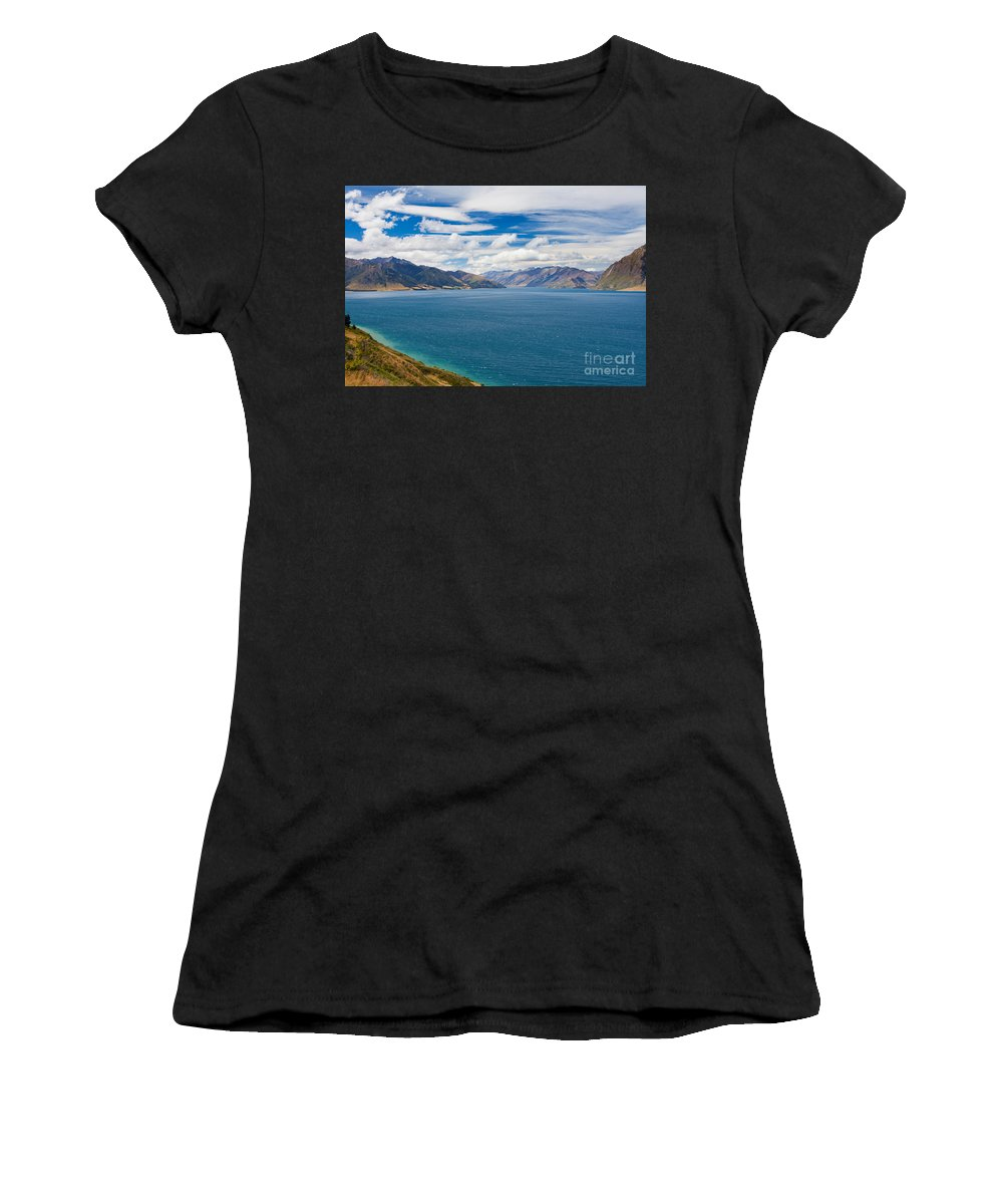 South Island Women's T-Shirt (Athletic Fit) featuring the photograph Blue Surface Of Lake Hawea In Central Otago Of New Zealand by Stephan Pietzko