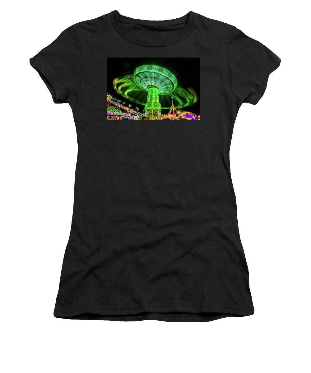 Photography Women's T-Shirt featuring the photograph Illuminated Fair Ride With Blurred Neon by Panoramic Images