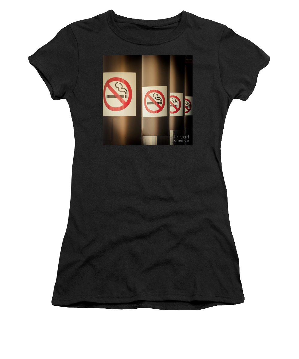 Addiction Women's T-Shirt (Athletic Fit) featuring the photograph Mobile Photography Toned Row Of No Smoking Signs by Stephan Pietzko