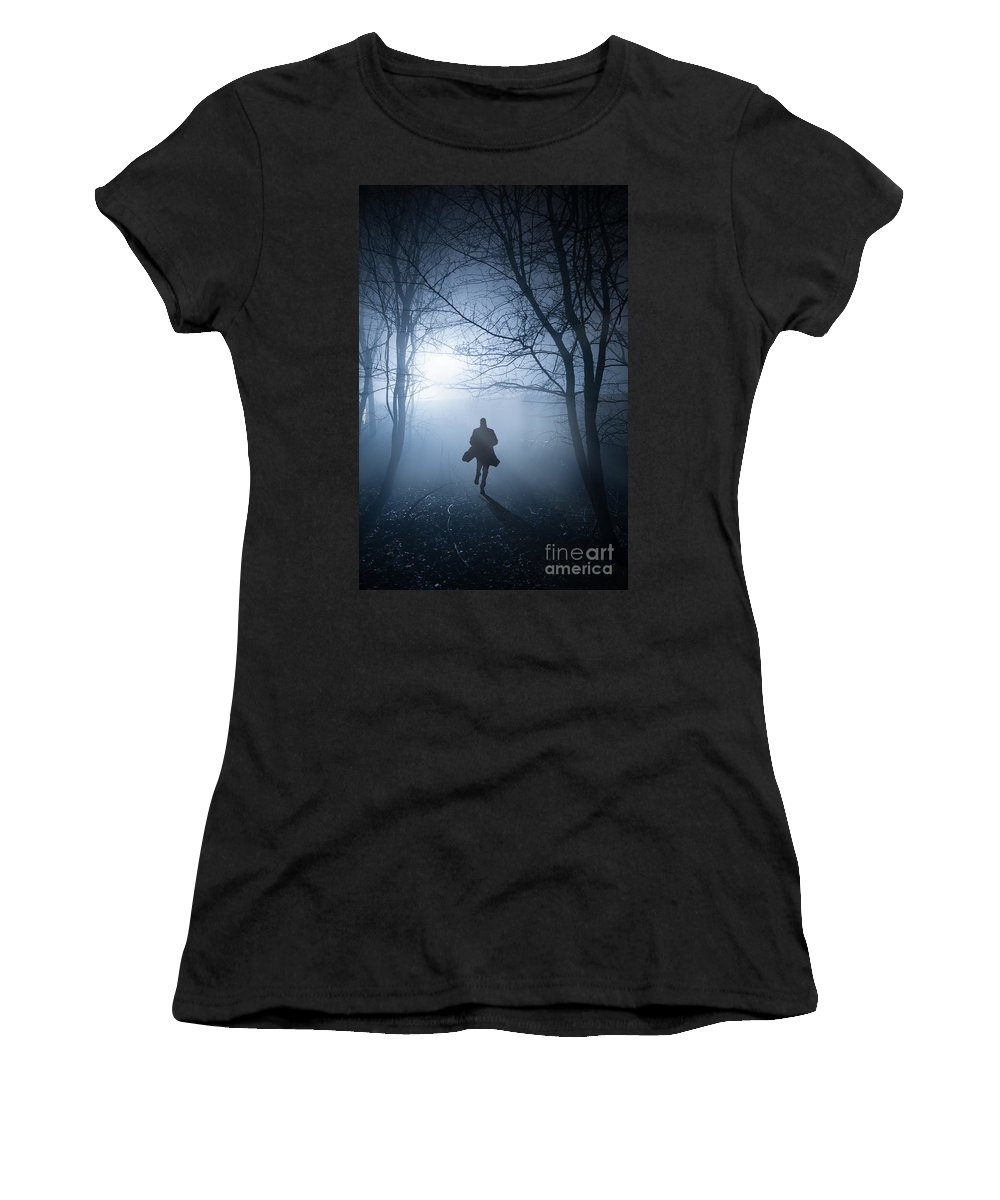 Man Women's T-Shirt (Athletic Fit) featuring the photograph Silhouette Man Running In Foggy Woodland by Lee Avison