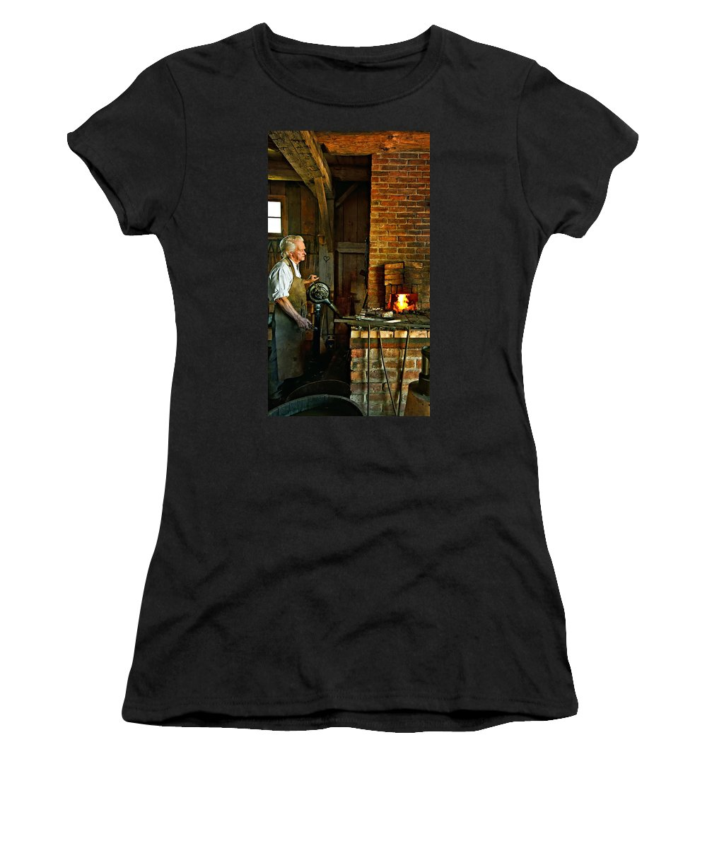 Blacksmith Women's T-Shirt (Athletic Fit) featuring the photograph The Blacksmith 2 by Steve Harrington