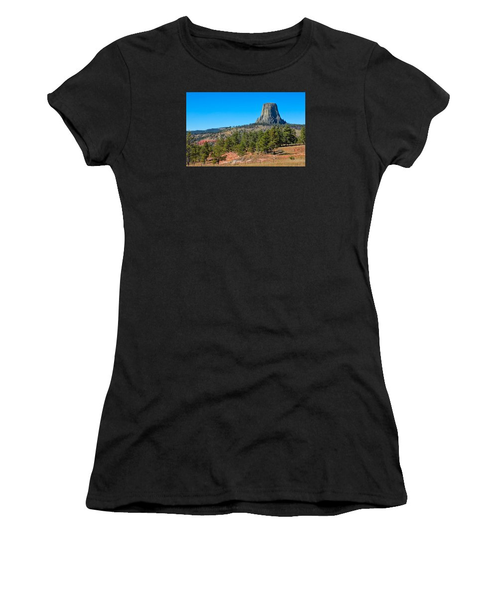 America Women's T-Shirt (Athletic Fit) featuring the photograph The Realm Of Devils Tower by John M Bailey