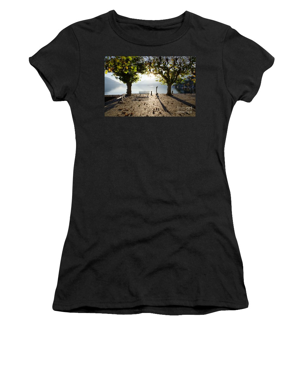 Bench Women's T-Shirt (Athletic Fit) featuring the photograph Bench And Trees On The Lake Front by Mats Silvan