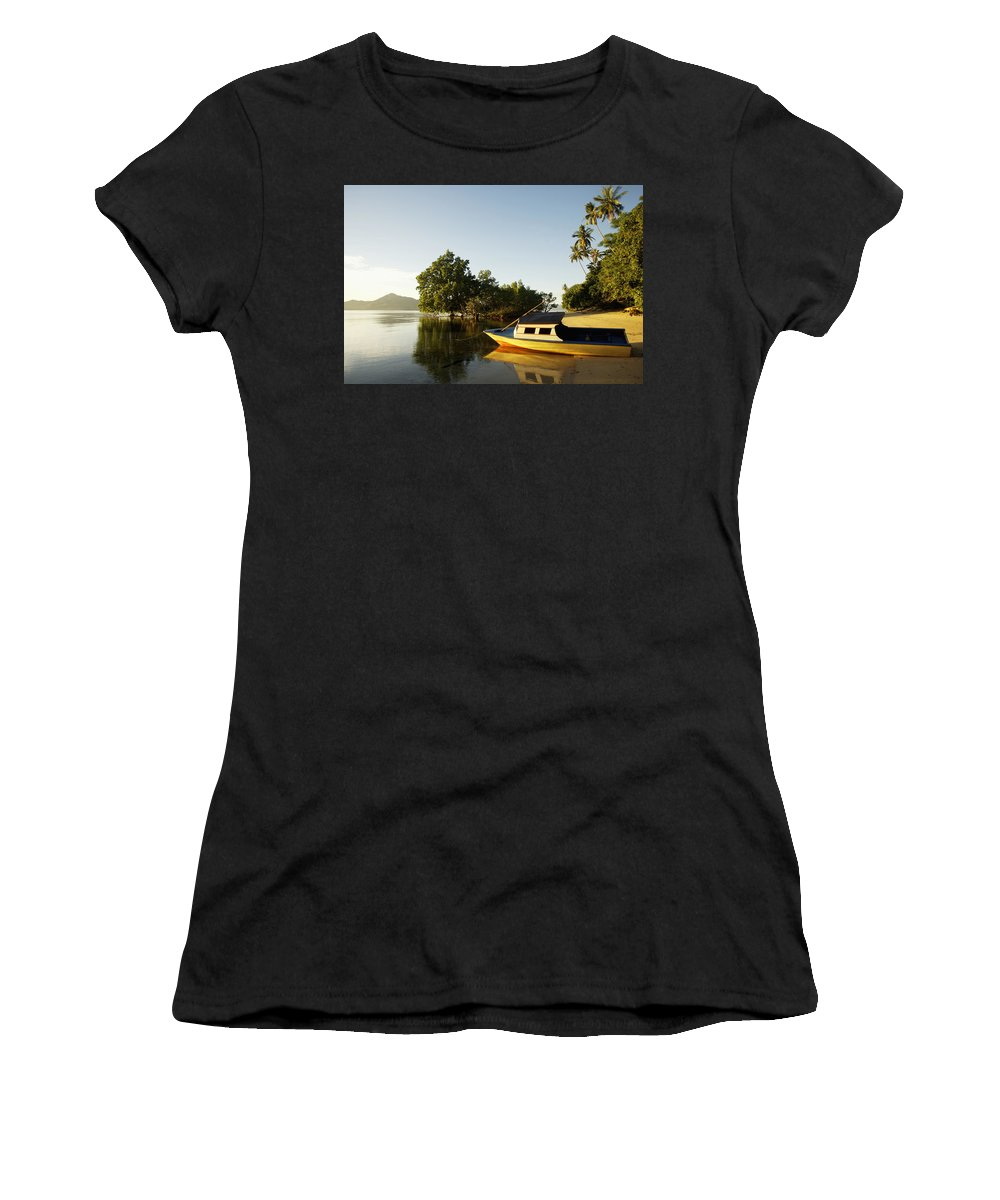 Photography Women's T-Shirt (Athletic Fit) featuring the photograph Boat On Sandy Beach by Axiom Photographic