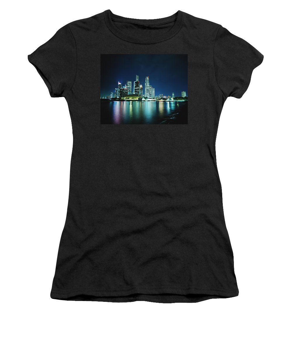 Water Women's T-Shirt (Athletic Fit) featuring the photograph Business District Skyline At Night by Axiom Photographic