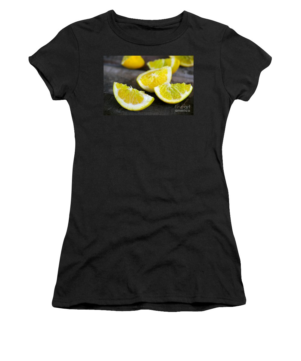 Antioxidant Women's T-Shirt (Athletic Fit) featuring the photograph Lemon Quarters by Carlos Caetano