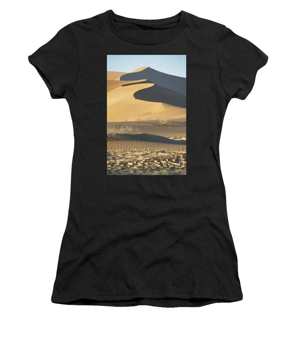 Sand Women's T-Shirt (Athletic Fit) featuring the photograph Sand Dunes In Namib Desert by Axiom Photographic