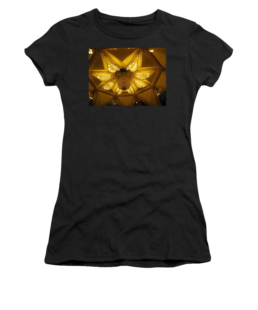 Temple Women's T-Shirt (Athletic Fit) featuring the photograph The Beautifully Lit Chandelier On The Ceiling Of The Iskcon Temple In Delhi by Ashish Agarwal