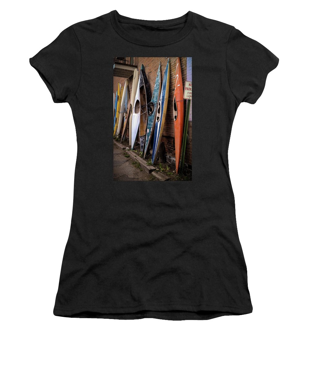 Kayaks Women's T-Shirt featuring the photograph Kayaks Lined Up On Wall by Steve Clouser