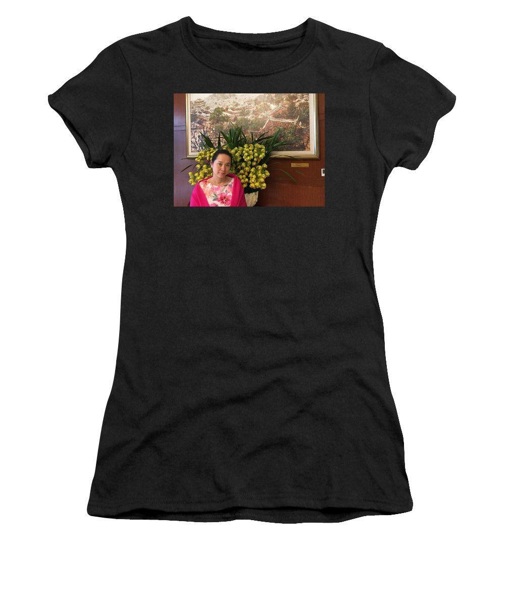 The Women Stands In Front Of A Large South Asian Orchid Bouquet Women's T-Shirt (Athletic Fit) featuring the photograph The Children's Book Writer by Connie Du