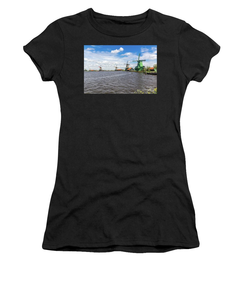 Canal Women's T-Shirt (Athletic Fit) featuring the photograph Traditional Dutch Windmills At Zaanse Schans, Amsterdam by Arnaud Martinez
