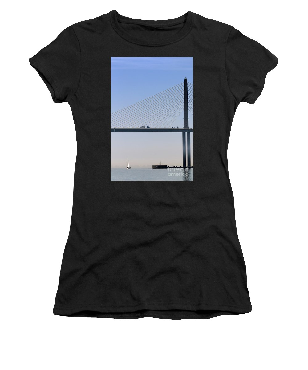 Sailing Women's T-Shirt (Athletic Fit) featuring the photograph A Sailing Boat Passes Under The Bridge In Tampa Bay by Louise Heusinkveld