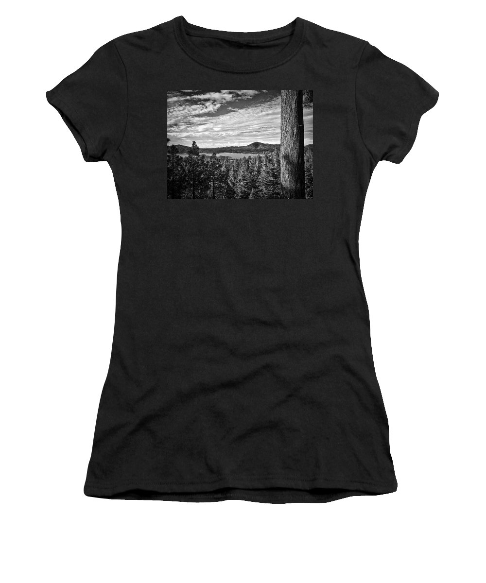 Tree. Big Bear Lake. Black And White. Pine Trees Women's T-Shirt featuring the photograph A Tree Stands Guard Over Big Bear Lake by Douglas Craig
