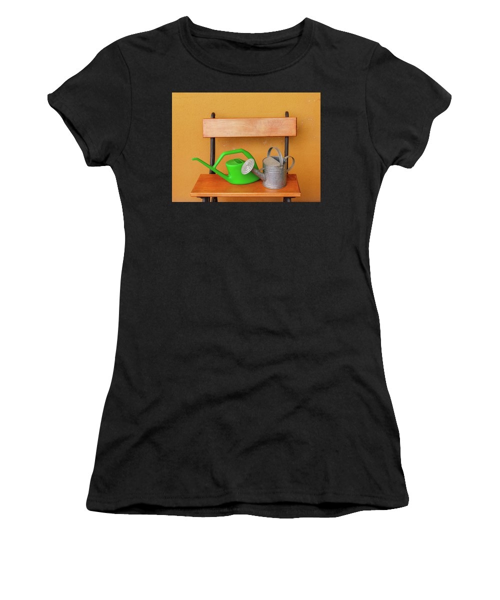 Watering-can Women's T-Shirt (Athletic Fit) featuring the photograph A Watering Can Of Aluminium And A Plastic One Laid On Wooden Bench by Susanna Mattioda