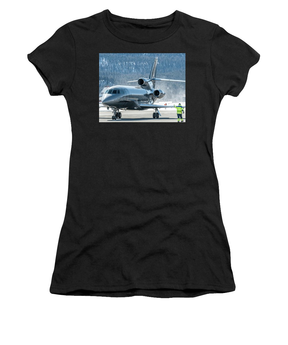 Samedan Women's T-Shirt (Athletic Fit) featuring the photograph Dassault Falcon 900 Parking With Marshaller by Roberto Chiartano