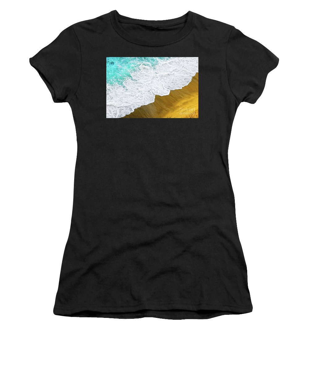 Water Women's T-Shirt (Athletic Fit) featuring the photograph Footsteps In The Sand Hopelessly Facing The Rising Tide by Silvia Ganora