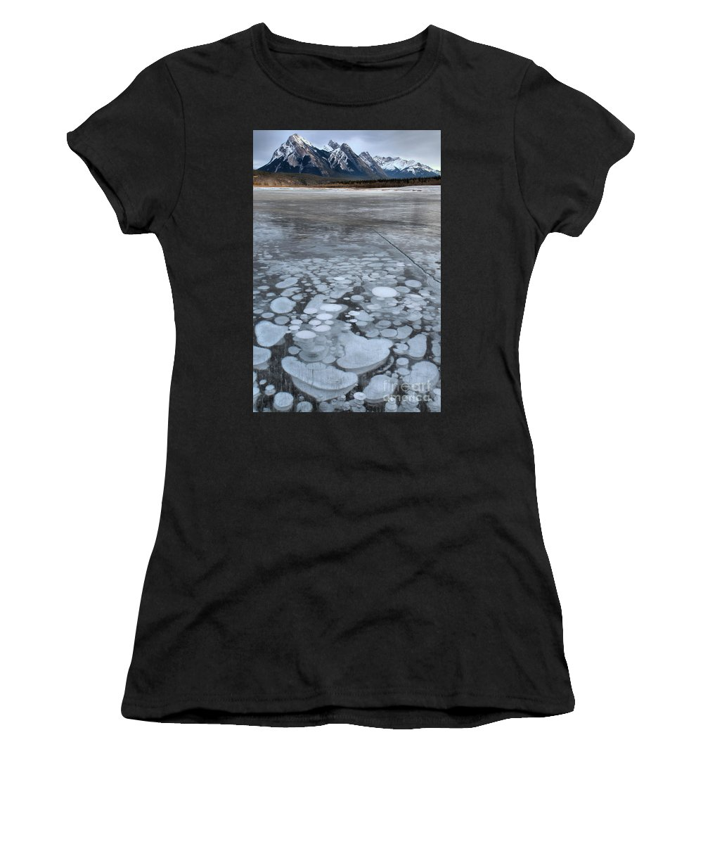 Abraham Lake Women's T-Shirt (Athletic Fit) featuring the photograph From Bubbles To Mountains by Adam Jewell