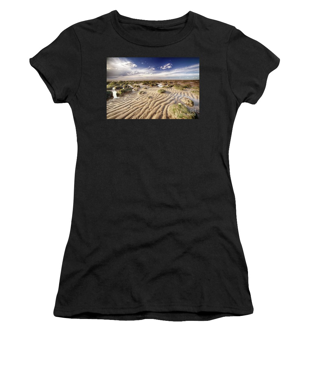 Sand Women's T-Shirt (Athletic Fit) featuring the photograph Golden Sand Lines And Seaweed Rocks Of Norfolk by Simon Bratt Photography LRPS