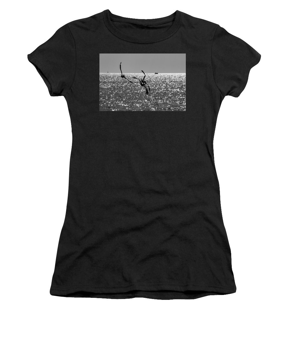 Pelican Women's T-Shirt featuring the photograph Pelicans Flying By - Black And White by Bob Slitzan