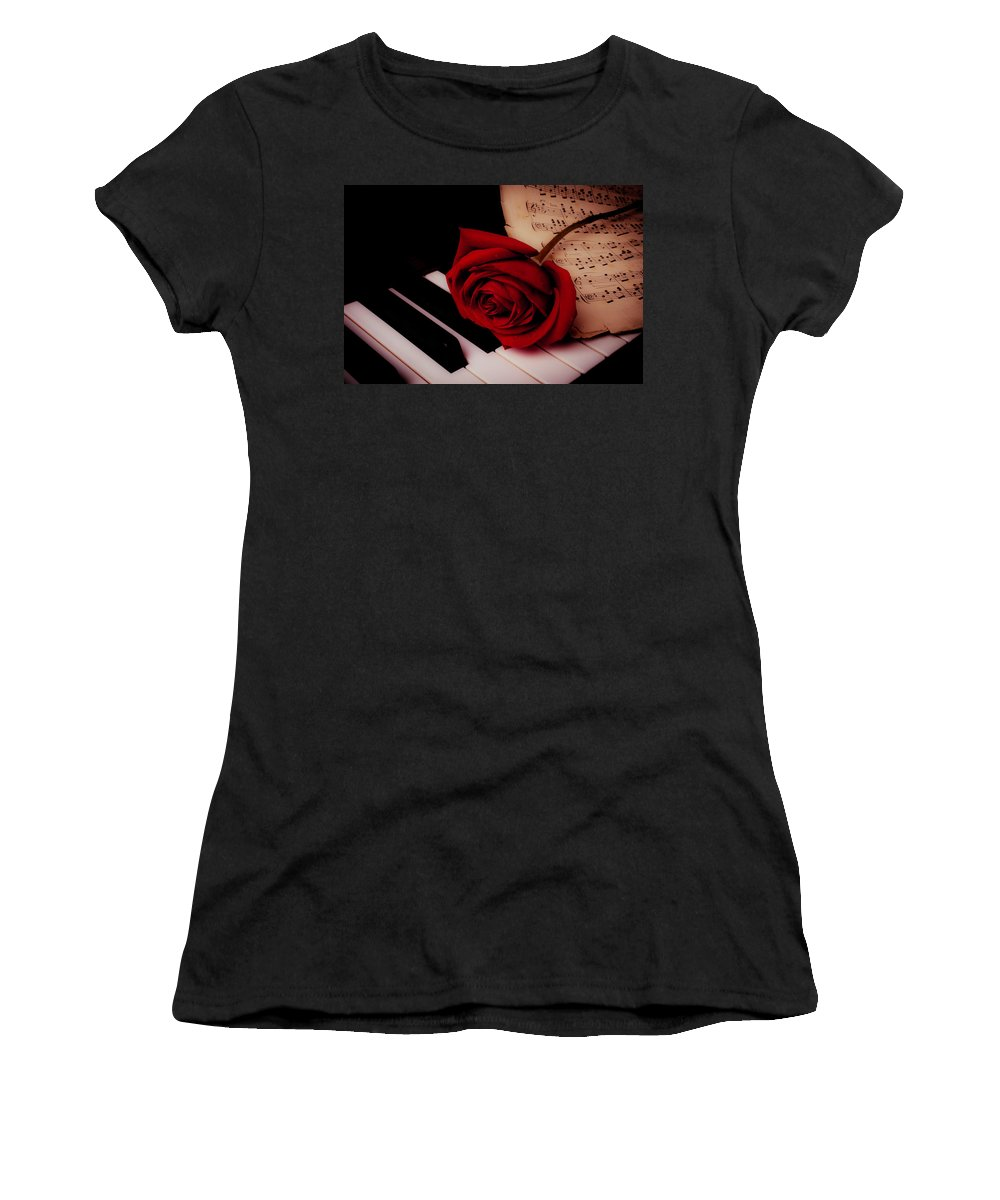 Red Rose Roses Women's T-Shirt featuring the photograph Rose With Sheet Music On Piano Keys by Garry Gay