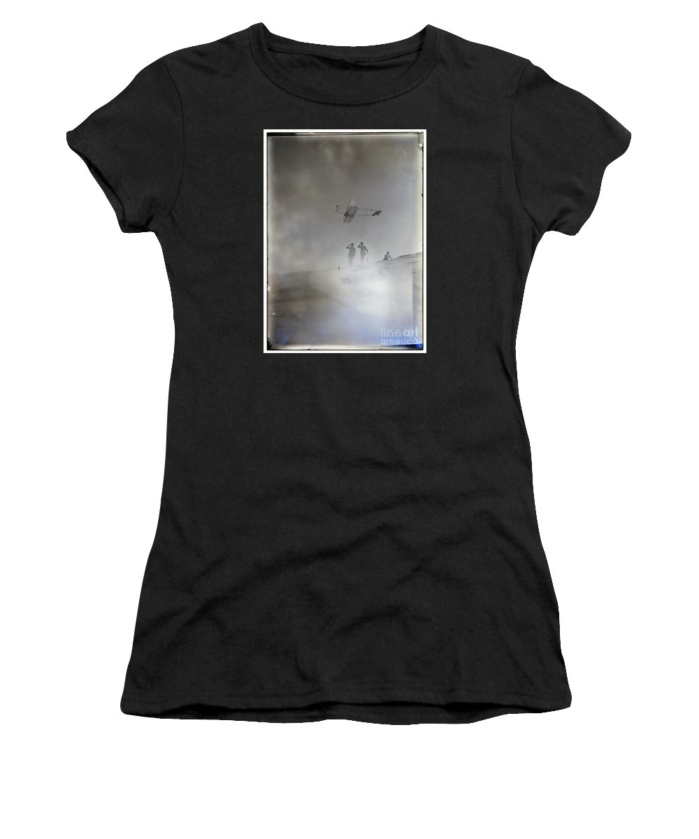 Side View From Below Of Orville Soaring In Level Flight Women's T-Shirt featuring the photograph Side View From Below Of Orville Soaring In Level Flight Spectators Looking Up At Glider Wright Broth by R Muirhead Art