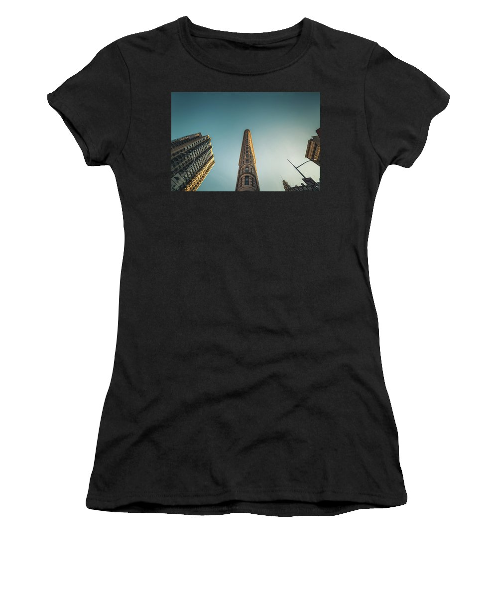 Building Women's T-Shirt (Athletic Fit) featuring the photograph The Flatiron Building Towering Over Manhattan by Erik Nuenighoff