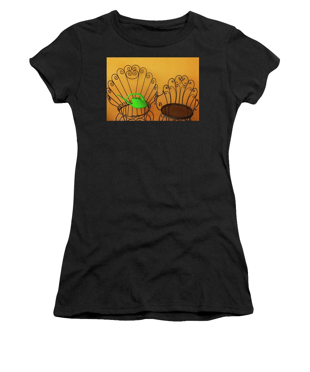 Chairs Women's T-Shirt (Athletic Fit) featuring the photograph Two Black Iron Chairs And A Green Watering-can Laid On The Big by Susanna Mattioda