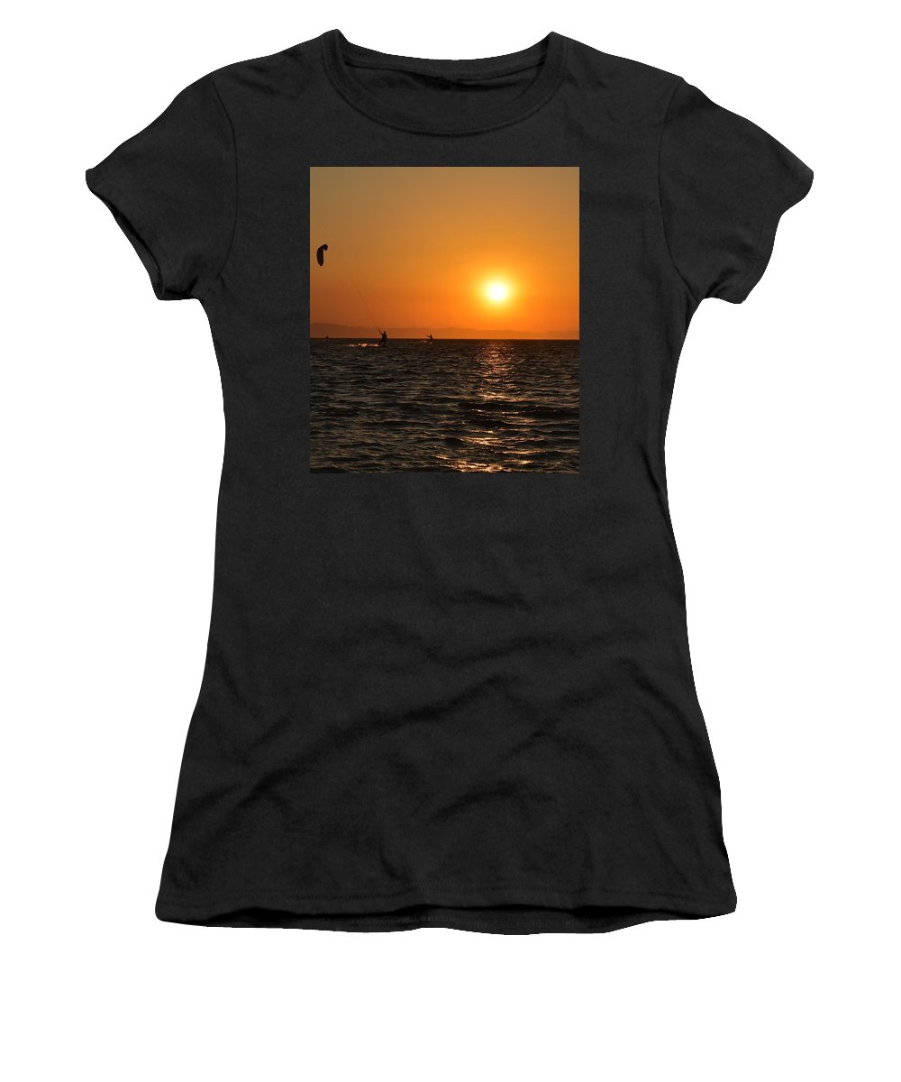 Kitesurfing Women's T-Shirt featuring the photograph Red sea sunset by Luca Lautenschlaeger