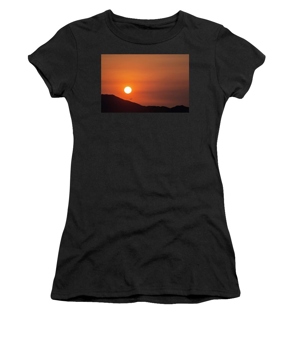 Sunset Women's T-Shirt featuring the photograph Red sunset and plane in flight by Hannes Roeckel