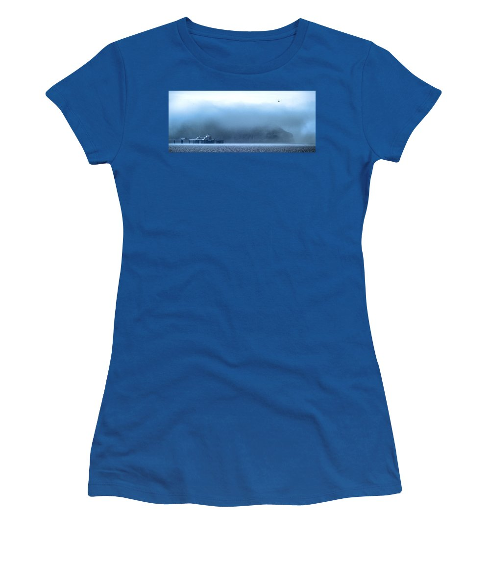 Pier Women's T-Shirt featuring the photograph The Sea Mist Lifts To Reveal The Great Orme Behind Llandudno Pier by Mal Bray