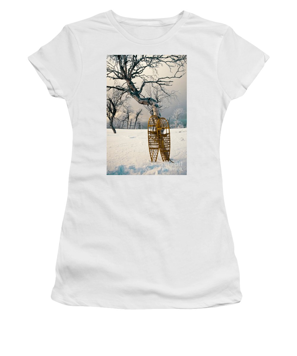 Alpine Women's T-Shirt (Athletic Fit) featuring the photograph Snowshoes Leaning Against Birch Tree Snowscape by Stephan Pietzko