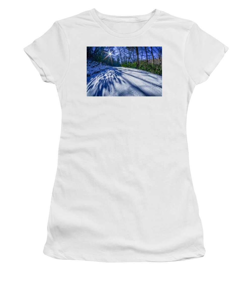 Snow Women's T-Shirt (Athletic Fit) featuring the photograph Snow Covered Road Leads Through The Wooded Forest by Alex Grichenko