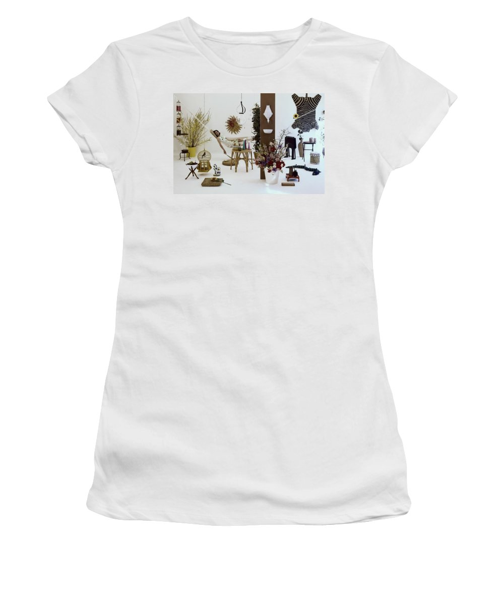 Indoors Women's T-Shirt featuring the photograph A Woman In A Hammock And Porch Furniture by Tom Yee