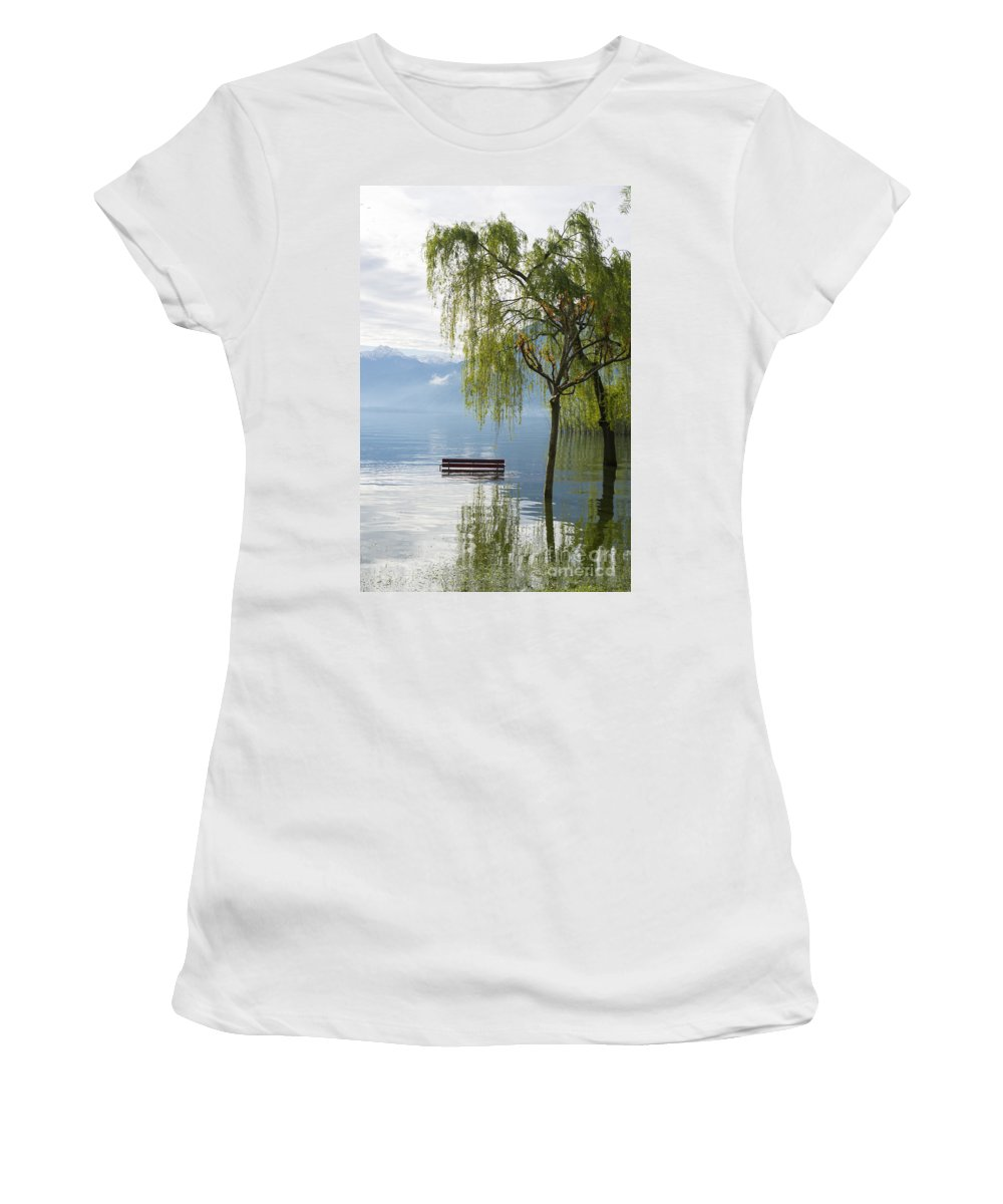Bench Women's T-Shirt (Athletic Fit) featuring the photograph Bench With Trees On A Flooding Alpine Lake by Mats Silvan