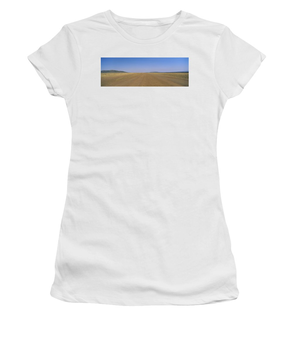 Photography Women's T-Shirt featuring the photograph Dirt Road Passing Through A Landscape by Panoramic Images