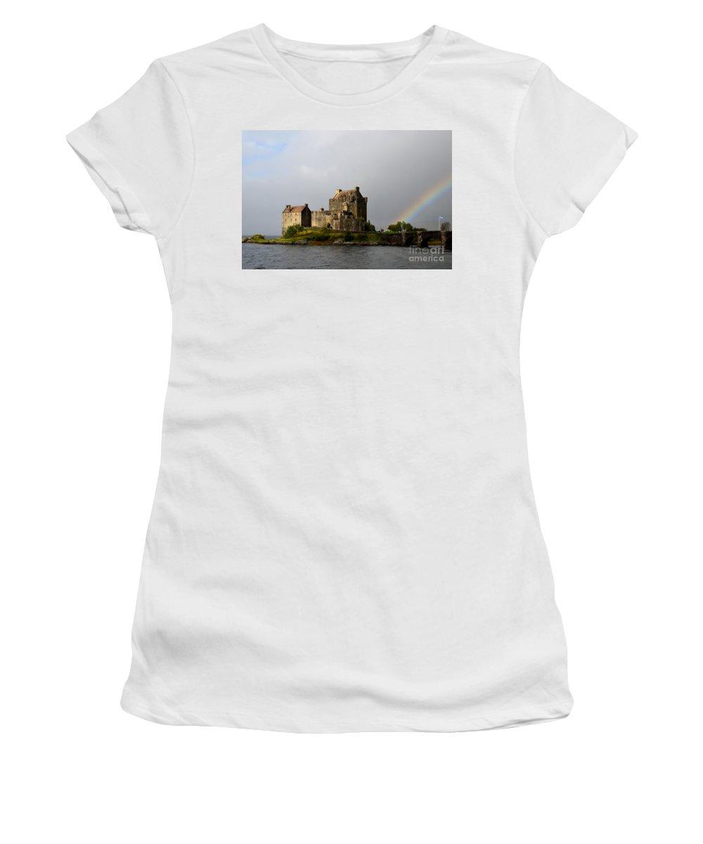 Eilean Donan Women's T-Shirt (Athletic Fit) featuring the photograph Eilean Donan With A Rainbow by DejaVu Designs