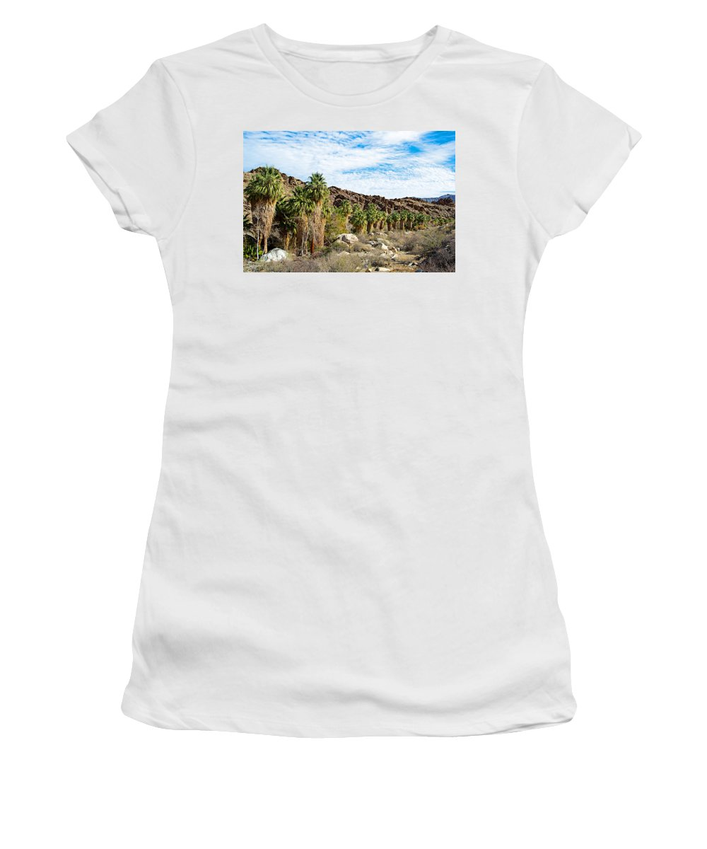 Fan Palms Line The Creek In Andreas Creek Rocks In Indian Canyons Women's T-Shirt (Athletic Fit) featuring the photograph Fan Palms Line The Creek In Andreas Canyon In Indian Canyons-ca by Ruth Hager