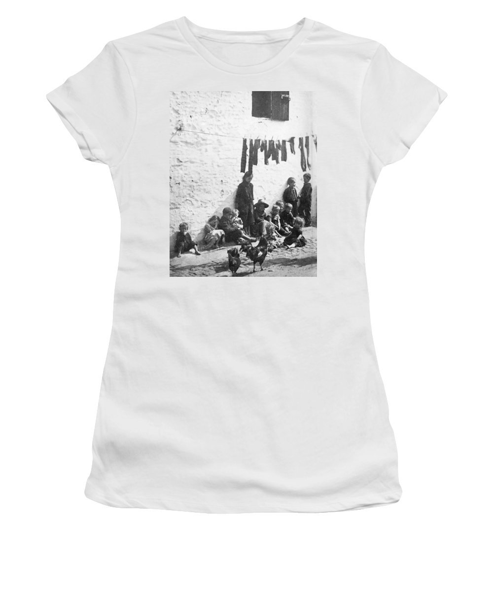 1890 Women's T-Shirt (Athletic Fit) featuring the photograph London Slum, C1890 by Granger