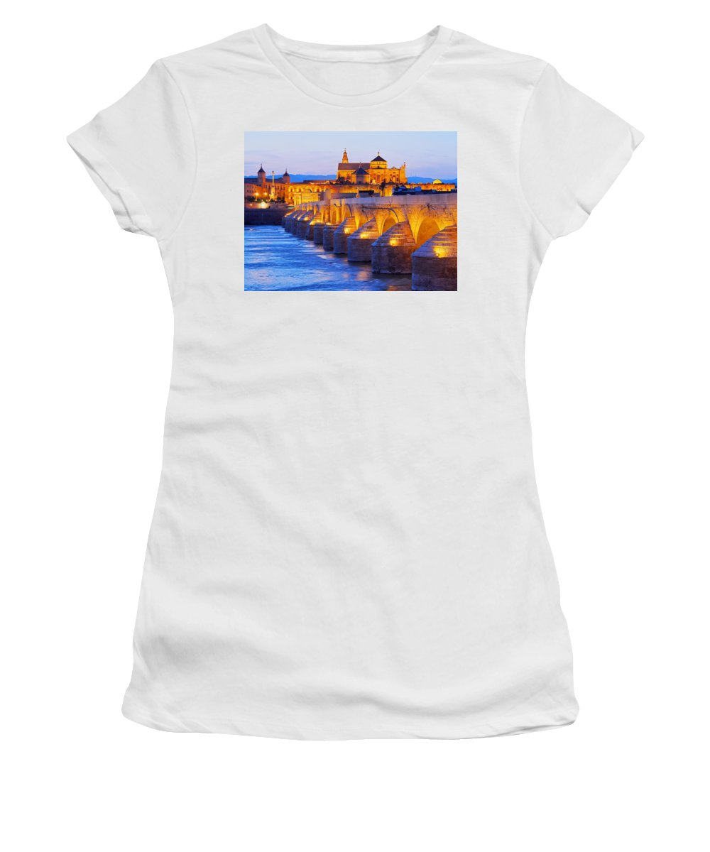 Cordoba Women's T-Shirt featuring the photograph Mosque-cathedral And The Roman Bridge In Cordoba by Karol Kozlowski