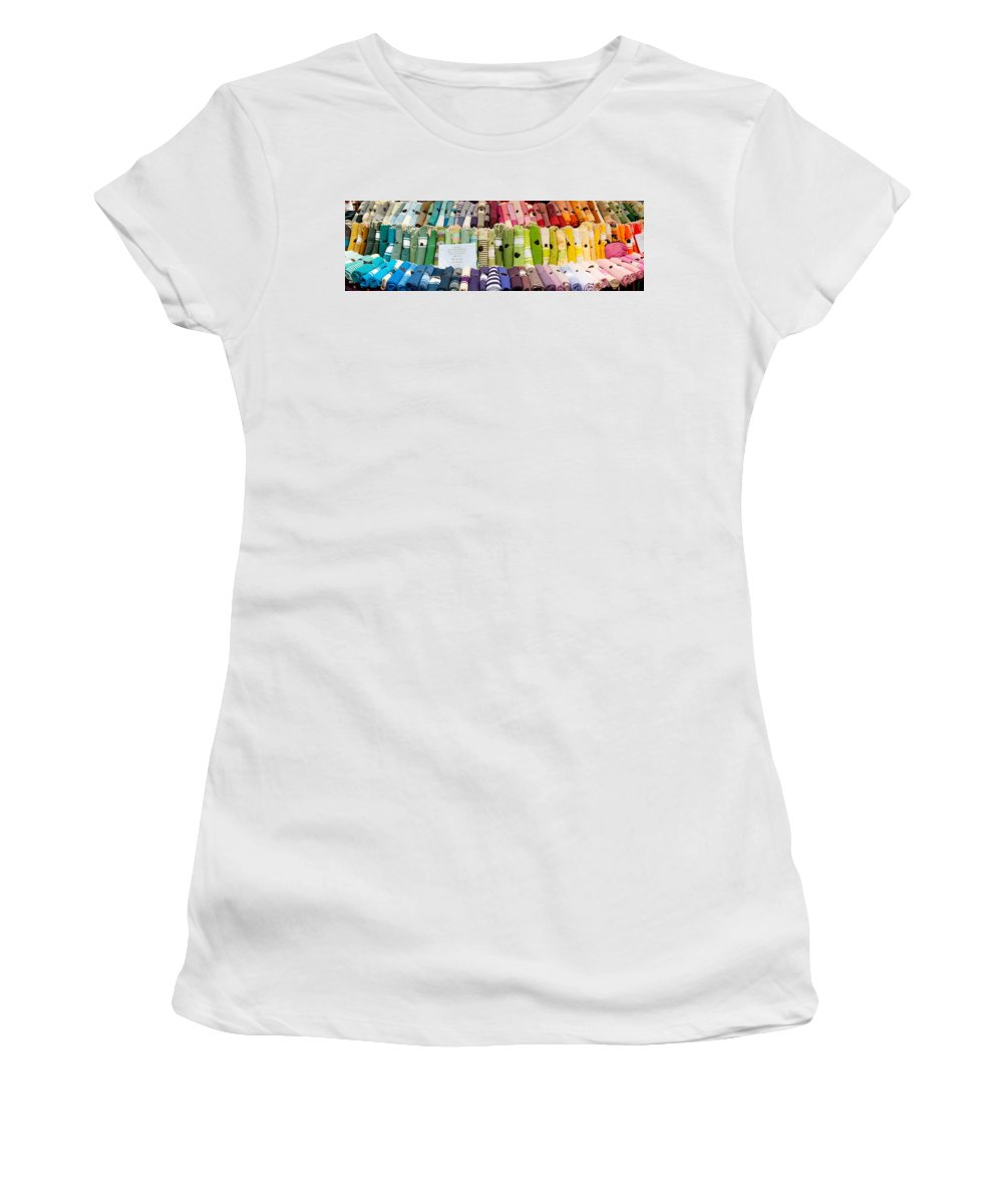 Photography Women's T-Shirt featuring the photograph Tablecloths For Sale At A Market Stall by Panoramic Images