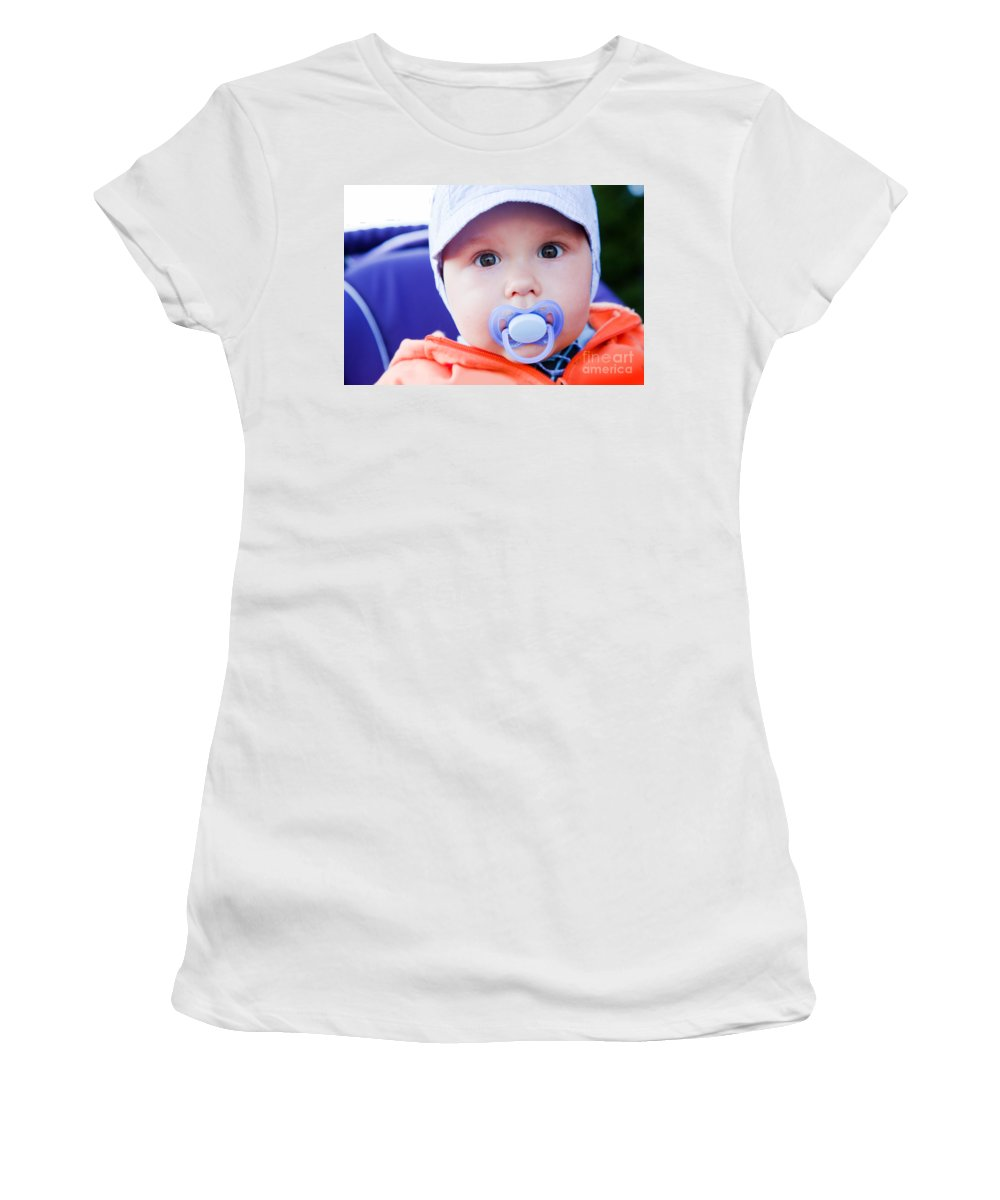 Child Women's T-Shirt featuring the photograph Young Baby Boy With A Dummy In His Mouth Outdoors by Michal Bednarek