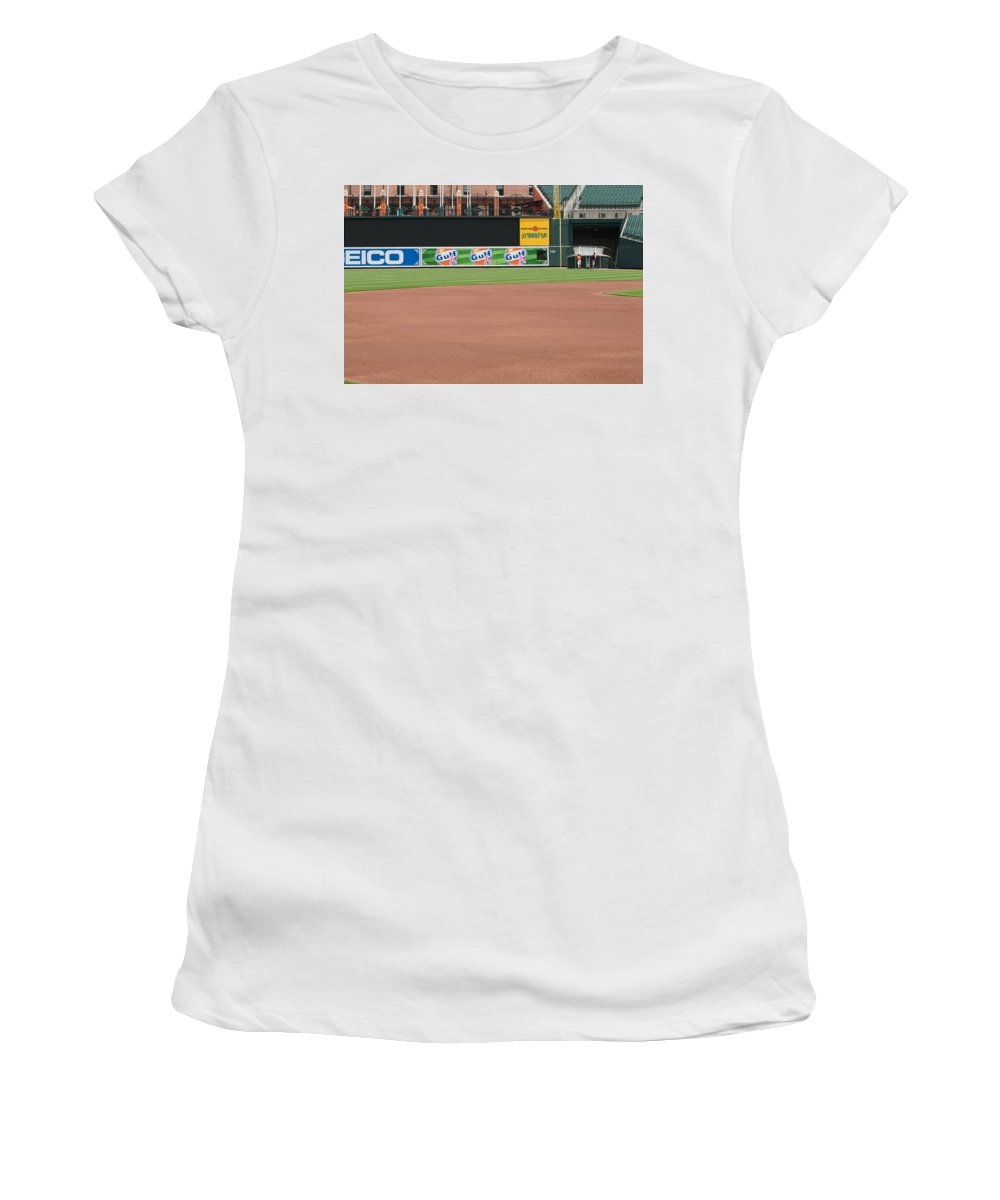 oriole Park Women's T-Shirt (Athletic Fit) featuring the Bringing Out The Batting Cage by Paul Mangold