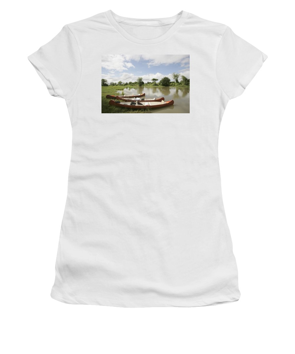 Zambia Women's T-Shirt (Athletic Fit) featuring the photograph Canoes On The Lower Zambezi by Axiom Photographic