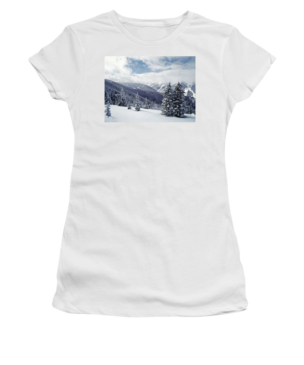 Photography Women's T-Shirt (Athletic Fit) featuring the photograph Snow Covered Pine Trees On Mountain by Axiom Photographic