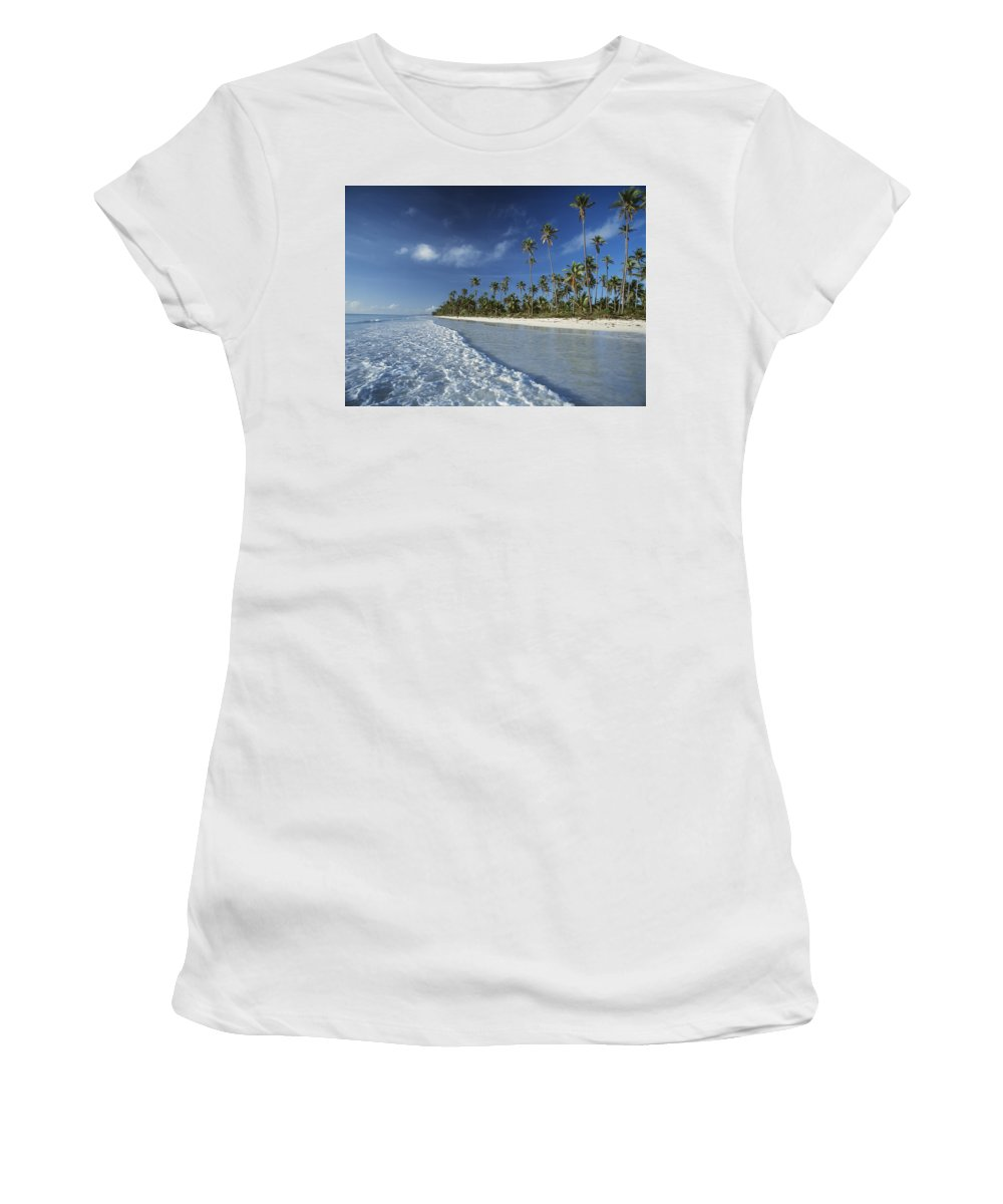Waves Women's T-Shirt (Athletic Fit) featuring the photograph Waves Lapping Shore Of Beach With Palm by Axiom Photographic