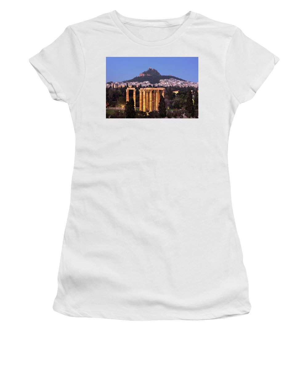 Ancient Women's T-Shirt (Athletic Fit) featuring the photograph View Of The Temple Of Olympian Zeus And Mount Lycabettus In The by Andrey Omelyanchuk